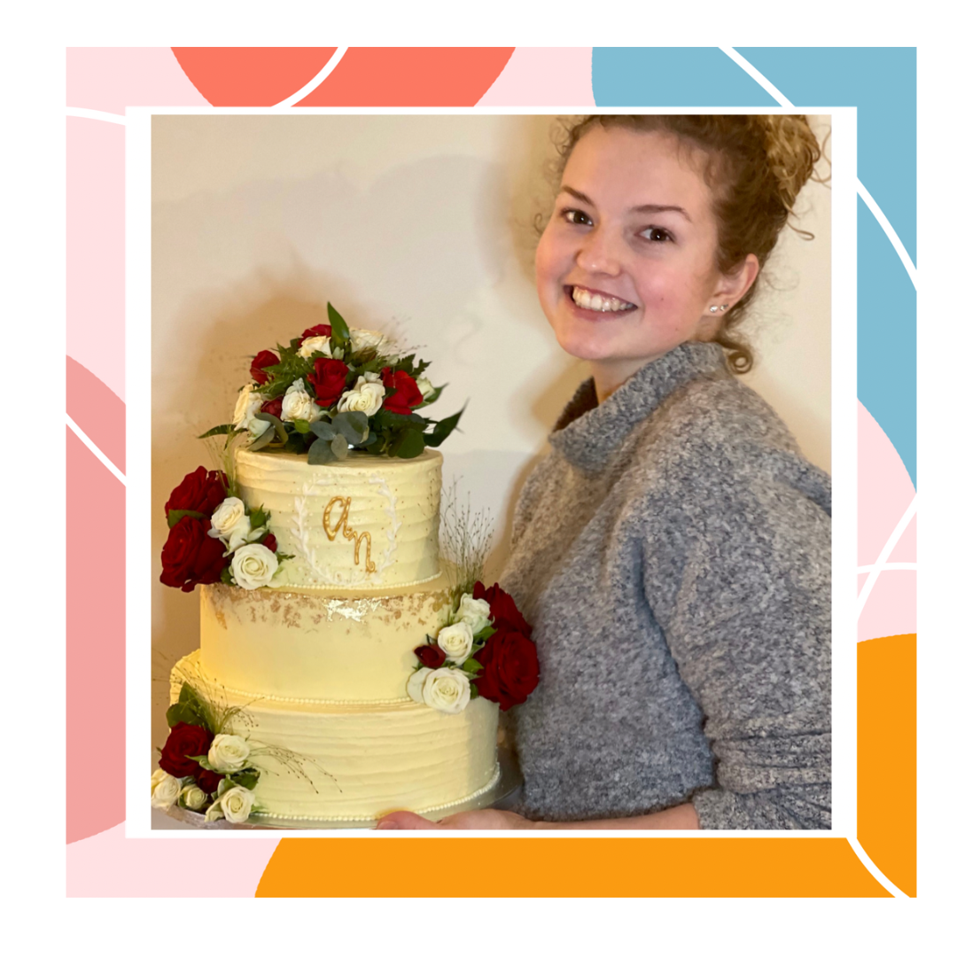 Holly holding a 3 tier wedding cake.